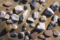 Stones. And bebbles over a shore rock Royalty Free Stock Image