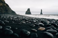 Stones on a black beach in Icelandn Stock Image