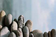 Pile of stones on a background of blue sky stock photos