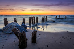Stones and breakwater at sunset Royalty Free Stock Images