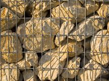 Stones in cage landscape. Lime stones in wire cage landscape Stock Image
