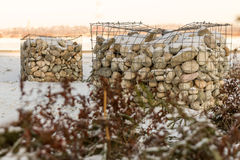 Stones in cages Stock Photography