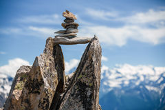 Stones cairn bridging gap near Eggishorn, Alps. Stones cairn bridging gap near Eggishorn peak, Alps, Switzerland Stock Image