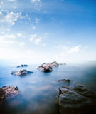 Stones calm sea. Long exposure shot Royalty Free Stock Images