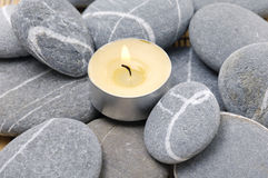 Stones and candle Stock Images