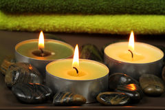 Stones and candles Stock Photography