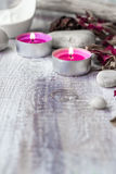Stones candles petals rose wooden background Stock Images