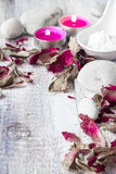 Stones candles petals rose wooden background Stock Photo