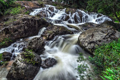 Stones and cascade waterfall Royalty Free Stock Photo