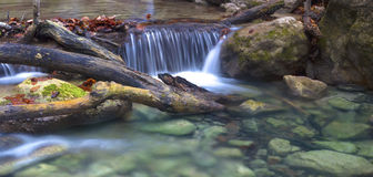 Stones in the clear water. Little waterfall in Crimea mountains in autumn Royalty Free Stock Photo