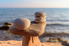 Stones on coast. Balancing some of stones on the seashore royalty free stock photos