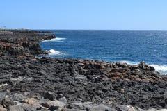 Stones and coast of Fuerteventura, Canary Island. Vulcanic stones on coast and sea waves on Fuerteventura island, near Caleta de Fuste. Canary Island royalty free stock photo