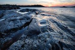 Stones on coast of the island Stock Photos