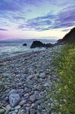 Stones and coastline Stock Images