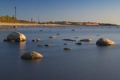 Stones, coastline and harbour Stock Photography