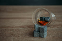 Stones for cooling whiskey and glases tulup on gark wooden background Stock Image