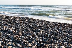 Stones Cover Shoreline at Torrey Pines State Beach. Stones cover the shoreline at Torrey Pines State Beach in San Diego, California stock image