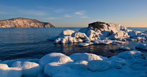 Stones covered with ice on the beach. Stock Photo