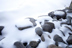 Stones covered by snow Stock Image