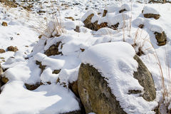 Stones covered with snow Stock Photos