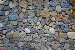 Stones of different colors. Wall of colored stones, masonry stones Royalty Free Stock Photos