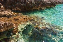 Stones of emerald lagoon in Adriatic Sea Royalty Free Stock Photos