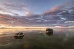 Stones family. Poland,sunset over the baltic sea Stock Photos