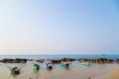 Stones and fishing boats Phu Quoc, Vietnam Stock Image