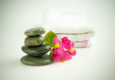 Stones with flower and towel. Isolated on white stock photo
