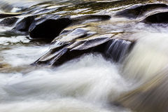 Stones in the flowing river. Close up shot Stones in the flowing river Royalty Free Stock Photos