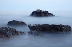 Stones in the fog Stock Image