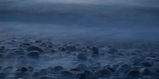Stones in the fog. Stones at the each in a mysterious fog Royalty Free Stock Image