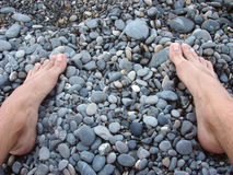 Stones and foots Royalty Free Stock Photos