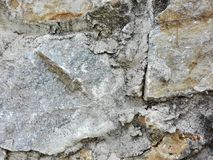 Stones that form a wall. Stone wall of a mountain house located in Sierra Nevada, presenting a background of textures Royalty Free Stock Photo
