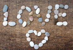 Stones with a form of the word love Stock Photography