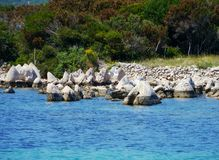 Stones in front of a Croatian island Royalty Free Stock Image