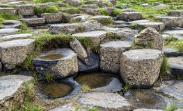 Stones Giant`s Causeway North Ireland. Stones of The Giant`s Causeway: 40,000 interlocking basalt columns, from an volcanic fissure royalty free stock images