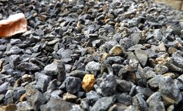 Stones gray. Beautiful gray, black, and yellow stones with nice details also with leave stock photos