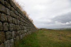 Stones of hadrian's wall. Stones stretching down Hadrian's wall in Cumbria, England royalty free stock images