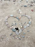 Stones heart on sand Stock Images