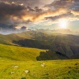 Stones on the hillside of mountain range at sunset royalty free stock image