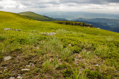 Stones on the hillside of mountain range Stock Image