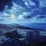 Stones on the hillside at night. White sharp stones on the hillside at night in full moon light Stock Photo