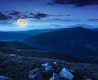 Stones on the hillside at night stock photo