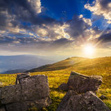 Stones on the hillside at sunset Royalty Free Stock Photos