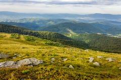 Stones on the hillside. White sharp stones on the hillside on top of mountain range Stock Photography