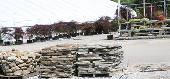Stones for Home Patios and Walkways. Stacks and slabs of custom stones and bricks   for ready for new home construction and patio projects Royalty Free Stock Photo