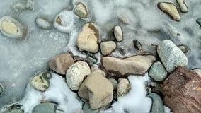 Stones and ice Stock Photos