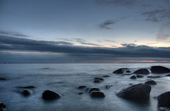 Stones In The Sea After Sunset Stock Image