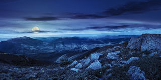 Stones In Valley On Top Of Mountain Range At Night Stock Images